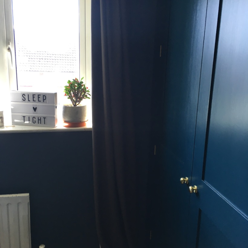 Dark walls and wardrobe in Farrow & Ball's Hague Blue