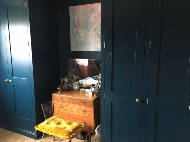 Dark walls and wardrobe in Farrow and Ball's Hague Blue